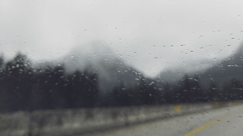 rainy blurred mountain road