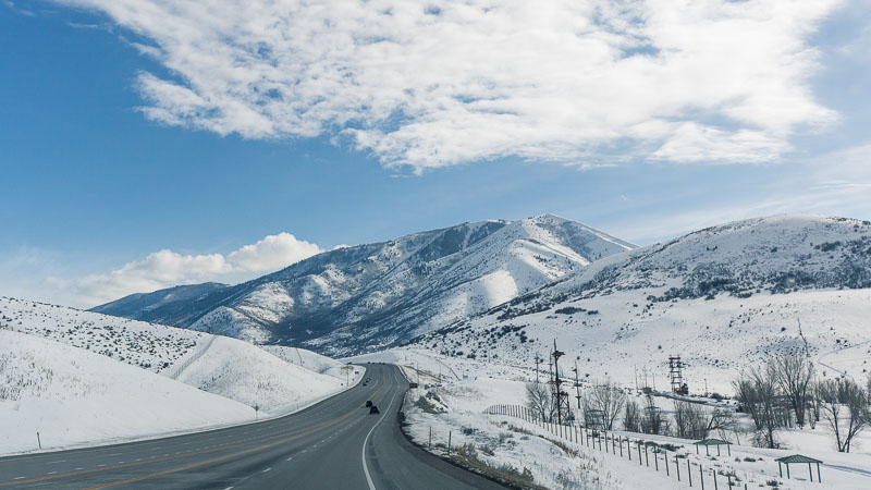 road through snowy mountain